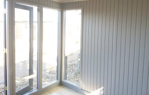 Floor-to-ceiling windows inside the 3.0 x 4.2m Salthouse Studio at Brighton painted in Farrow & Ball Down Pipe