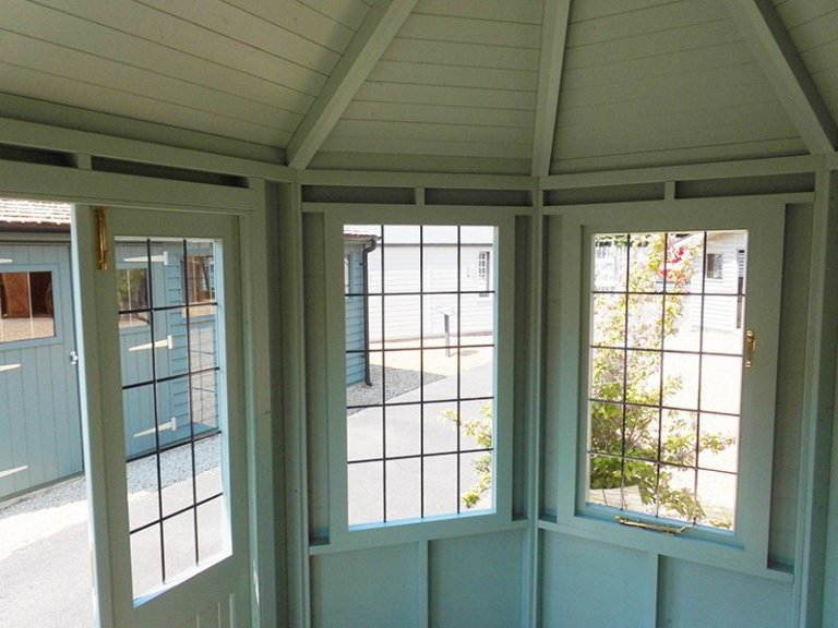 Leaded windows inside the 2.4 x 3.0m Classic Summerhouse at Burford with painted exterior and interior in Seagrass