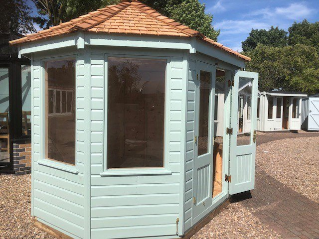 Nottingham's 2.4 x 3.0m Classic Summerhouse painted in Classic Paint System shade Seagrass