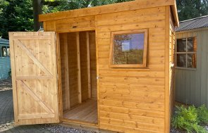 1.8 x 2.4m Superior Shed at Trentham with open door treated with a Sikkens Wood Stain in the shade Teak
