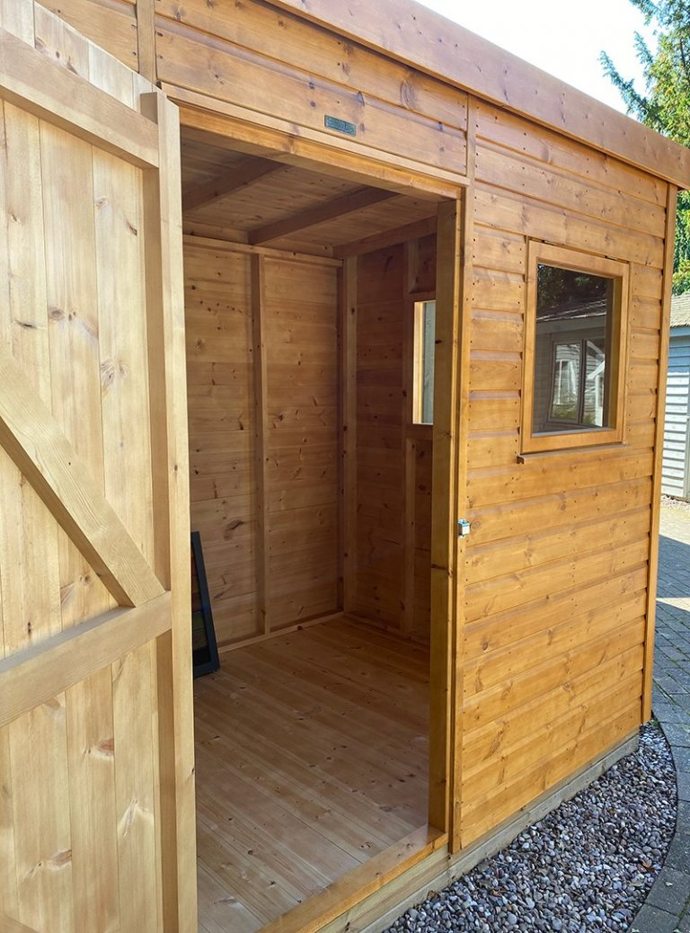 Inside the 1.8 x 2.4m Superior Shed at Trentham treated with a Sikkens Wood Stain in the shade Teak