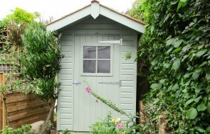 Small Superior Shed with roof overhang and Georgian window in the door