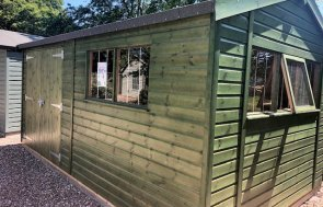 Nottingham Superior Shed treated with a Green Sikkens Wood Stain measuring 3.0 x 4.8m