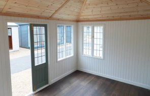 Inside the Cley Summerhouse at Burford with Ivory Painted Matchboard on the walls and Dark Oak Engineered Flooring