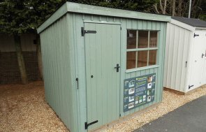 Oxburgh Shed measuring 1.8 x 2.4m painted in Terrace Green at our Burford Show Centre