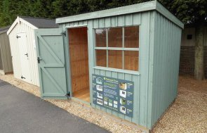 Traditional National Trust Oxburgh Shed with open door measuring 1.8 x 2.4m painted in Terrace Green at our Burford Show Centre