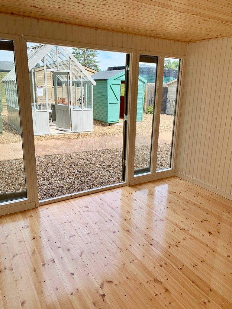 Inside the Ash painted Salthouse Studio with storage partition at Sunningdale