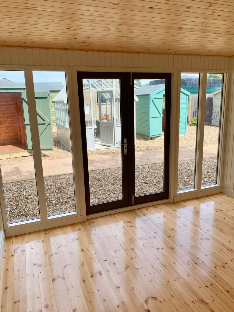 Interior of the Ash painted Salthouse Studio with storage partition at Sunningdale
