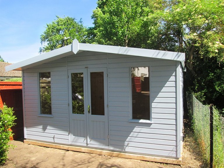 4.2 x 3.6m Fully Lined & Insulated Blakeney Summerhouse painted in Sundrenched Blue
