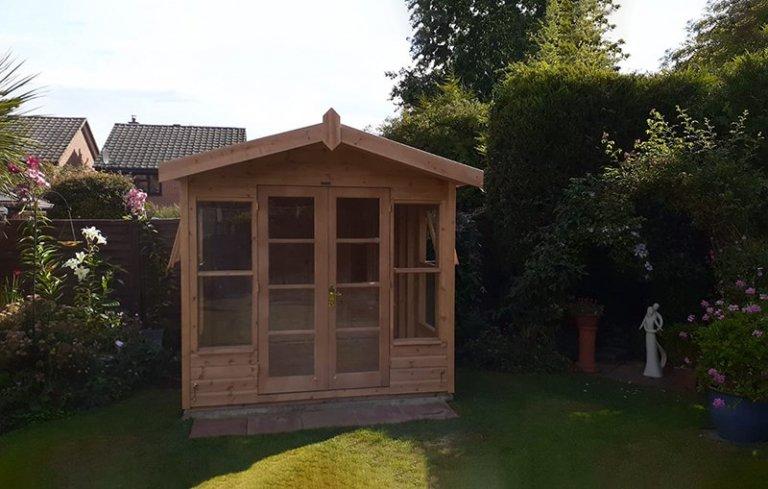 2.4 x 2.4m Unlined Blakeney Summerhouse treated with a Light Oak Preservative