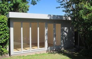 3.0 x 5.2m Salthouse Studio with storage partition painted in Exterior Pebble, with stylish pent roof design