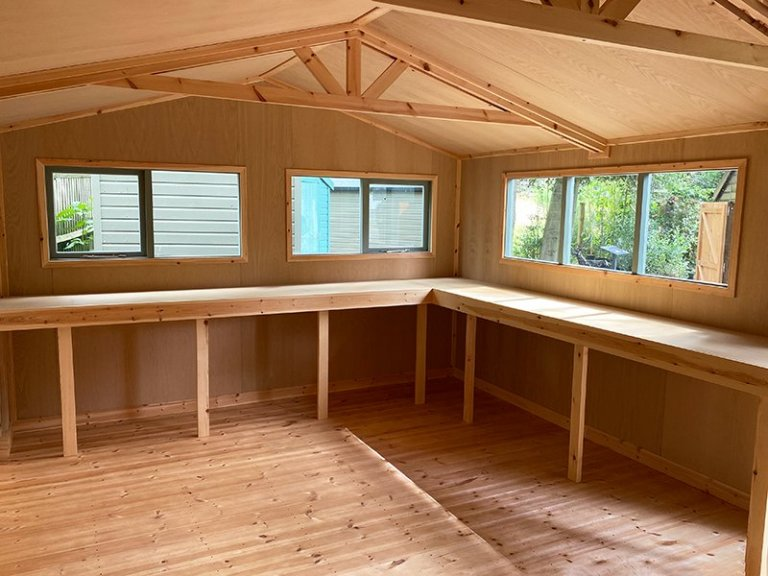 Workbenches inside Trentham's Lined and Insulated Sage Superior Shed