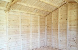 Inside Sunningdale's 3.0 x 4.8m Superior Shed treated with a Walnut Sikkens wood stain