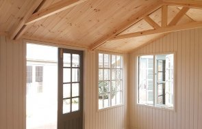 Doors and windows inside Brighton's 3.0 x 4.2m Holkham Summerhouse painted in Ash from our exterior paint system