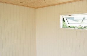 Inside Brighton's 2.4 x 4.2m Salthouse Studio with Partition painted in Twine from our exterior paint system