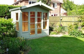 2.4 x 1.8m Chalet-Style Blakeney Summerhouse painted in Lizard from our exterior paint system