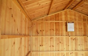 IInterior of Narford's 2.4 x 2.4m Ickworth National Trust Summerhouse painted in Terrace Green