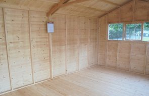 Inside Newbury's 3.0 x 4.8m Superior Shed treated with a Grey Sikkens wood stain