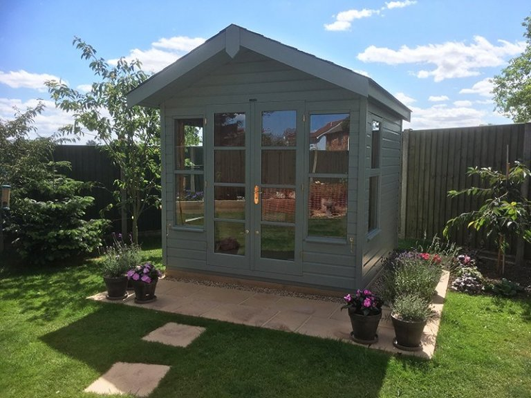 2.4 x 2.4m Blakeney Summerhouse in Exterior Sage with Grey Slate Effect Tiles on the Apex Roof