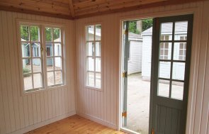 Inside the 3.0 x 3.6m Cley Summerhouse at Sunningdale painted in Exterior Sage