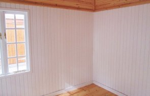 Interior of the 3.0 x 3.6m Cley Summerhouse at Sunningdale painted in Exterior Sage
