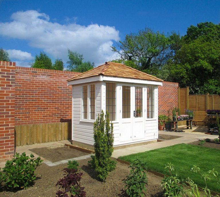 1.8 x 2.4m Hipped Roof Cley Summerhouse painted in Exterior Cream