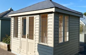 Side view of Nottingham's 2.4 x 3.0m Cley Summerhouse painted in Farrow & Ball Light Gray