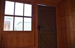 Door and window inside the 2.4 x 3.0m National Trust Blickling Shed at Narford HQ painted in Wades Lantern