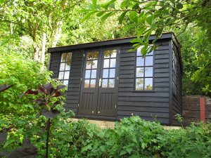 3.0 x 3.6m Weatherboard Clad Holkham Summerhouse painted in Exterior Black