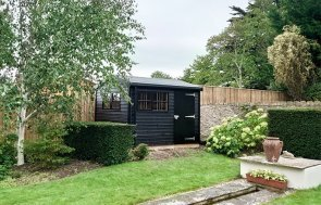 2.4 x 3.0m Superior Shed treated with a Black Sikkens wood stain
