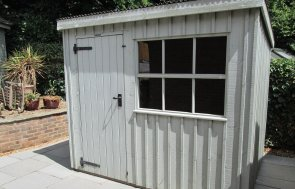 1.8 x 2.4m Oxburgh National Trust Shed painted in Disraeli Green