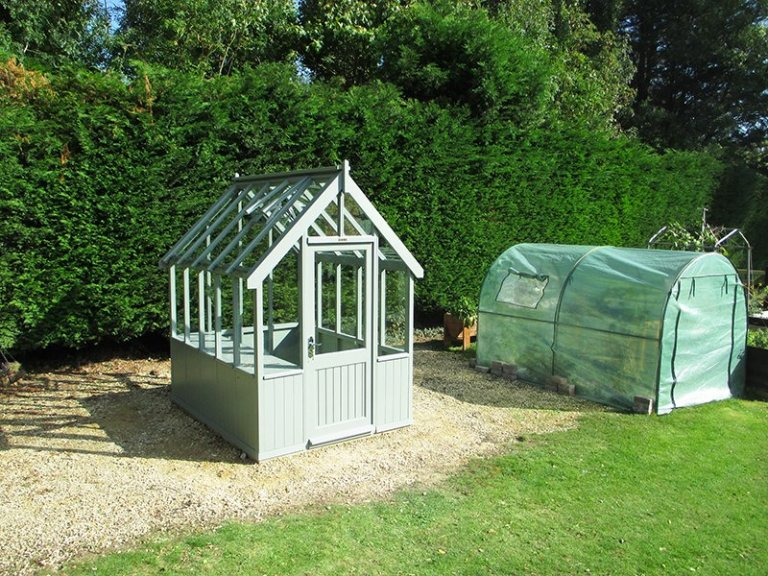 1.8 x 2.4m Greenhouse in Exterior Sage Paint with slatted Workbench inside