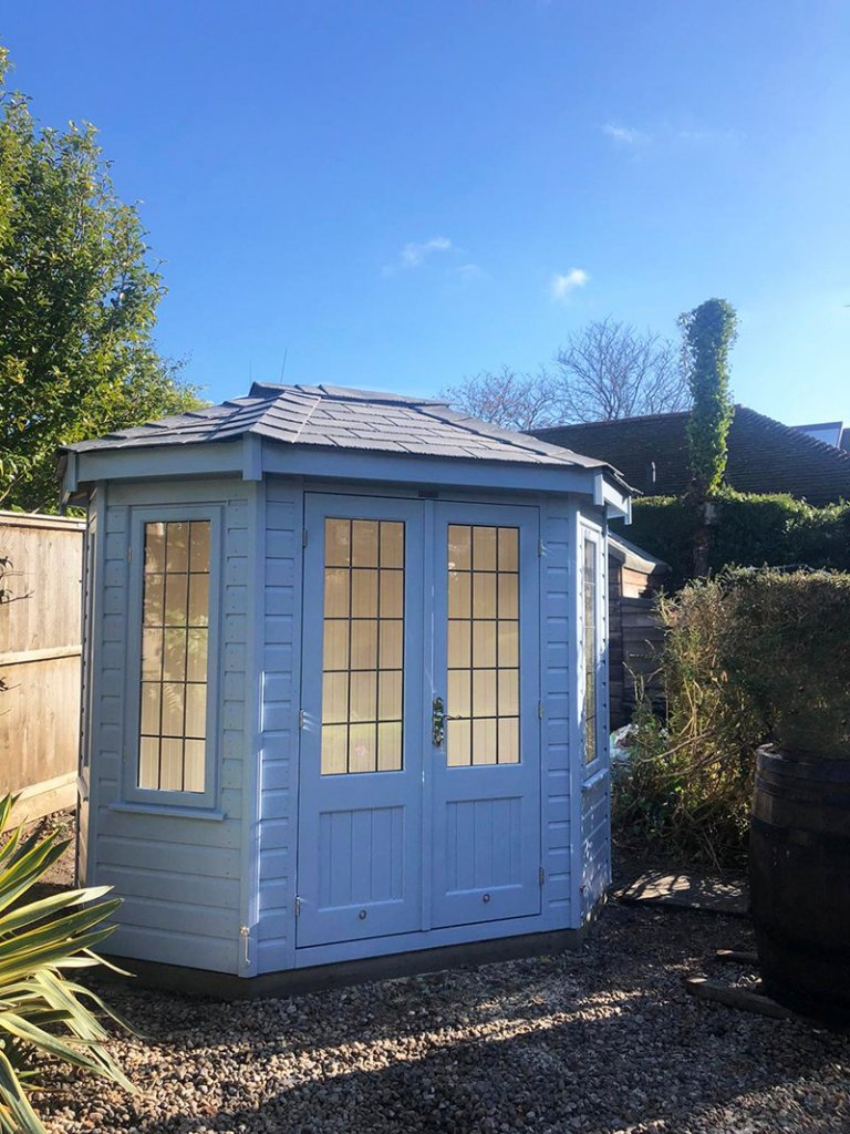 1.8 x 2.5m Wiveton Summerhouse in Exterior Sundrenched Blue Paint with Grey Slate Effect tiles on the roof