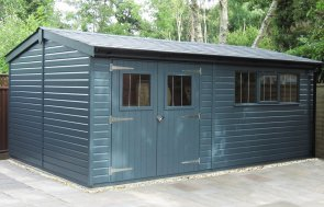 3.6 x 5.4m Superior Shed painted in Exterior Slate with a french drain around it