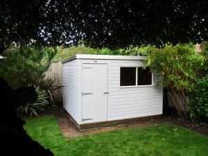 2.4 x 3.0m Classic Shed painted in Classic Smoke with pent roof design