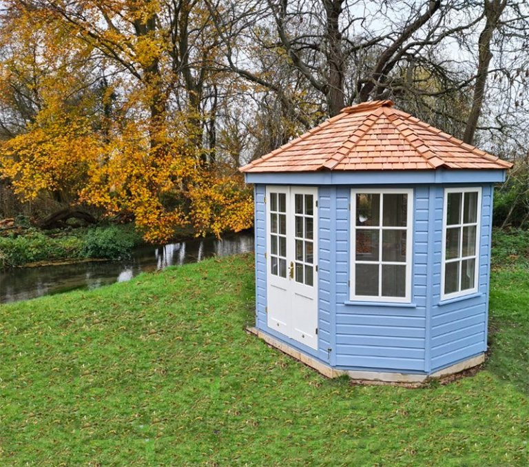 2.4 x 3.0m Wiveton Summerhouse in Exterior Sundrenched Blue and Ivory Paint with two sets of double doors and 6 opening windows