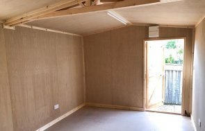 Inside an Insulated 3.0 x 4.8m Garage lined with Oak Faced Ply