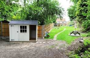 1.8 x 3.0m Blickling National Trust Shed with built in log store
