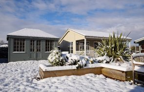 A Cley Summerhouse & Pavilion Garden Room  at our Narford show centre in the snow