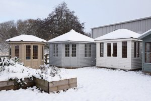 A selection of Summerhouses at our Narford show centre in the snow