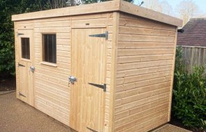 1.8 x 3.6m Superior Shed treated with a Light Oak Preservative with a Pent Roof Design