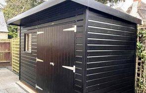 1.8 x 3.6m Superior Shed in Sikkens Black with Pent Roof Design