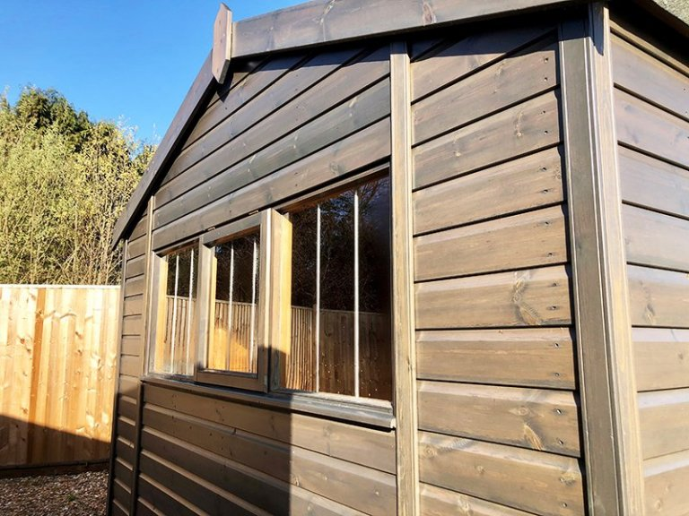 Close up of Cranleigh's 3.0 x 4.8m Superior Shed in Sikkens Grey