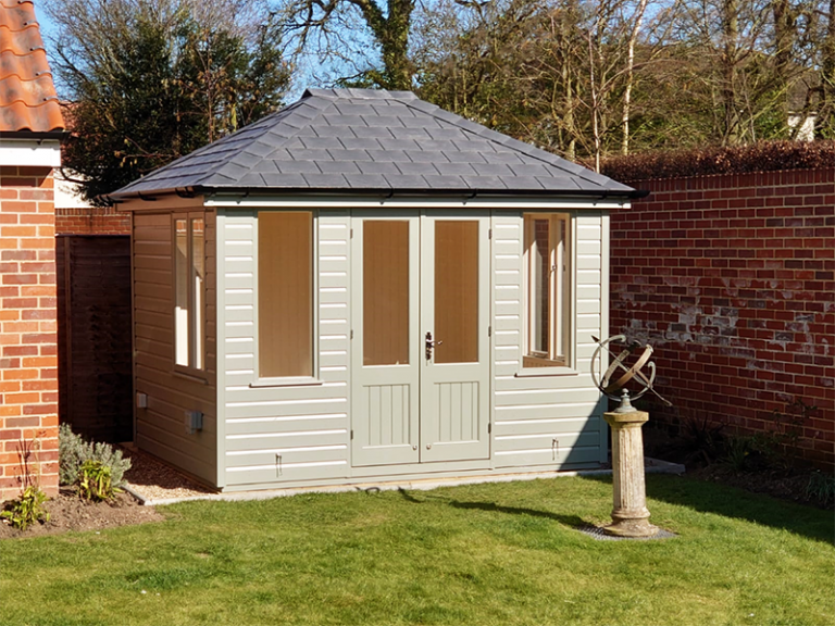 2.4 x 3.0m Cley Summerhouse painted in Farrow & Ball Pigeon with Grey Slate Effect Roof Tiles