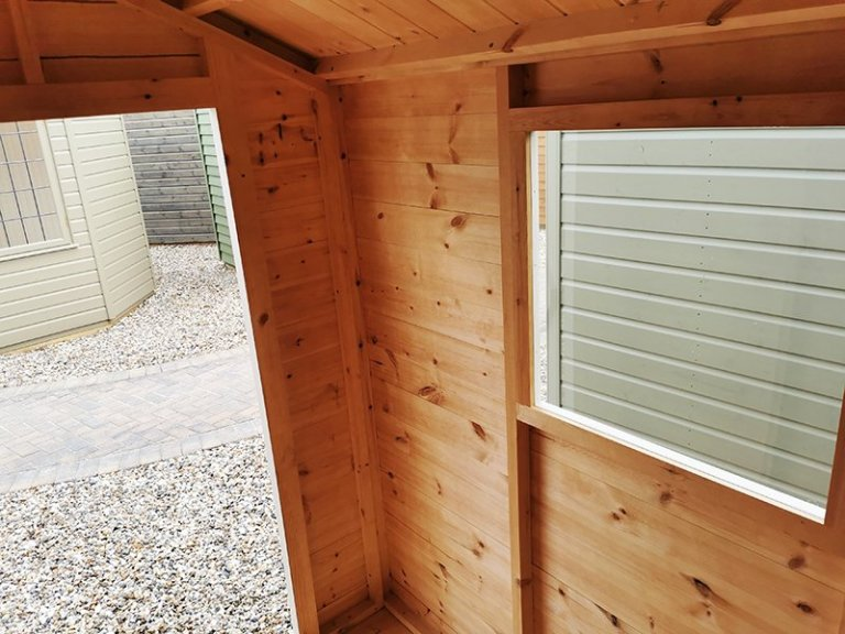 Interior of Sevenoaks' 1.5 x 2.1m Classic Shed painted in Classic Cotton