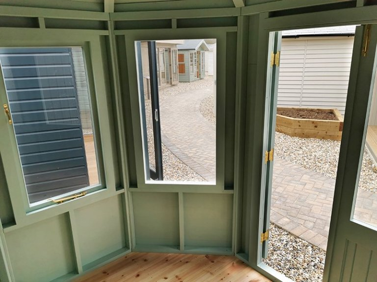 Inside Sevenoaks' 2.4 x 3.0m Classic Summerhouse Painted in Seagrass