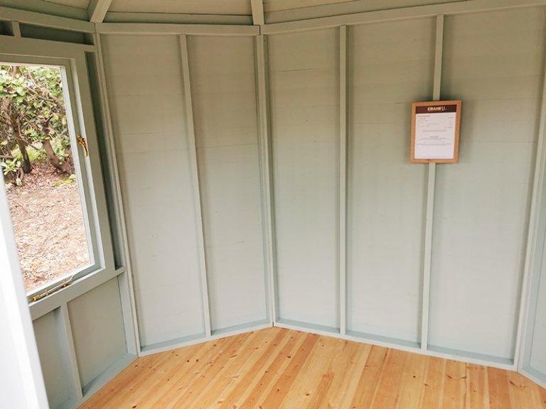 Interior of Sevenoaks' 2.4 x 3.0m Classic Summerhouse Painted in Seagrass