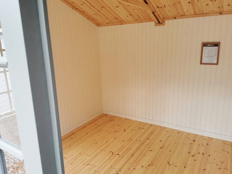 Inside Sevenoaks' 3.0 x 4.2m Holkham Summerhouse in Exterior Ash Paint with Farrow & Ball Pointing Matchboard Lining and Natural Lacquered Floor