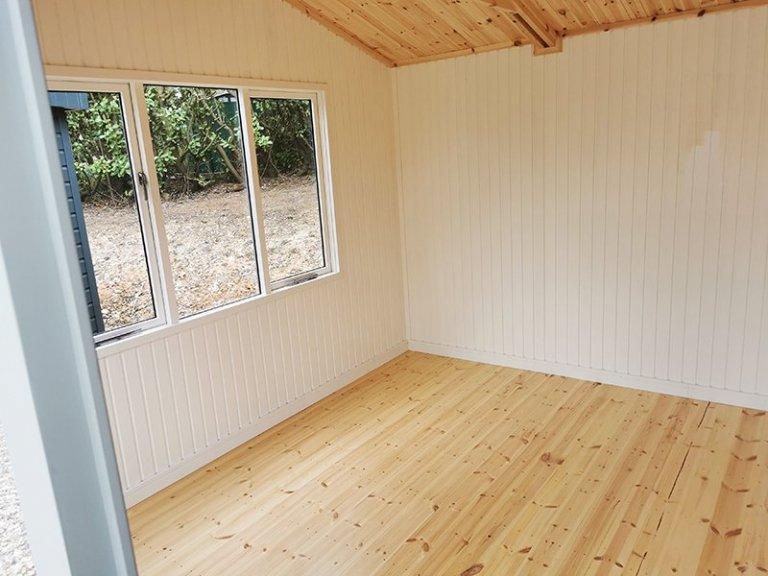 Interior of Sevenoaks' 3.6 x 4.2m Langham Studio in Exterior Ash Paint