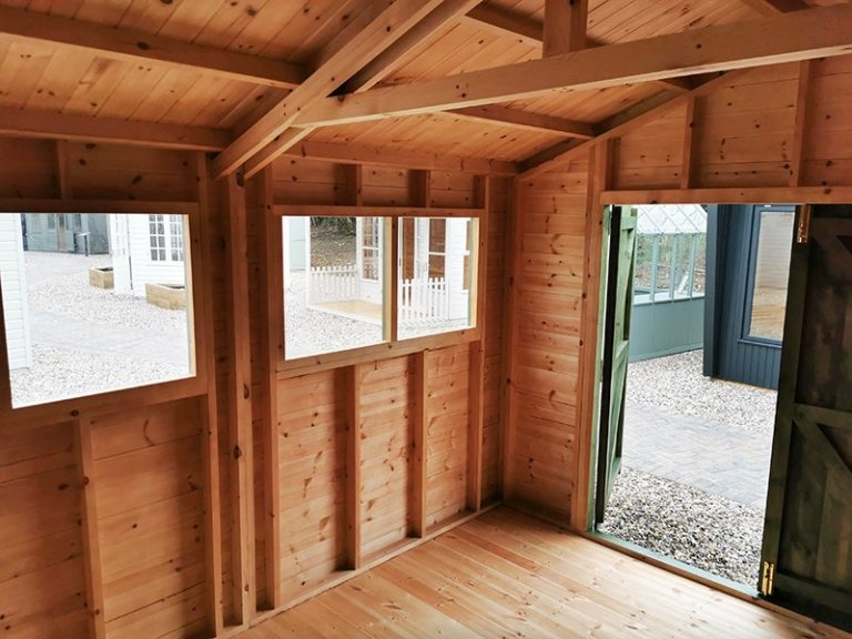 Inside Sevenoaks' 3.0 x 3.6m Superior Shed Treated with a Green Sikkens Wood Stain